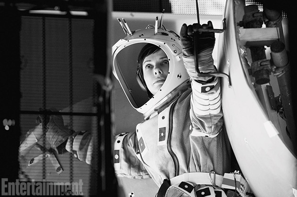 Gravity | Inside the light box, which projected motion-controlled light onto her face, Bullock was strapped to one of several rigs that would move her body to…