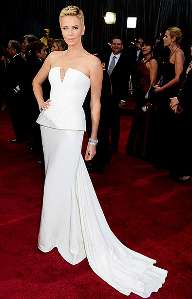 Style, Style: Red Carpet | She wasn't a nominee, but with that white Dior Haute Couture bustier dress, those Harry Winston diamonds, and her post-movie pixie hair , Theron was…