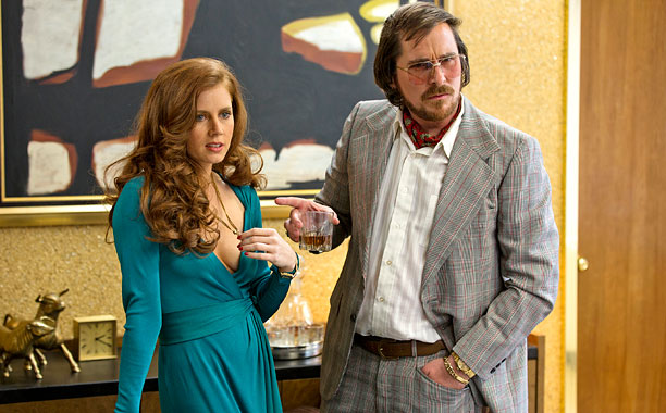American Hustle is inhabited by colorful and cunning con artists (Christian Bale and Amy Adams, playing partners and lovers), a somewhat unhinged FBI agent (Bradley…