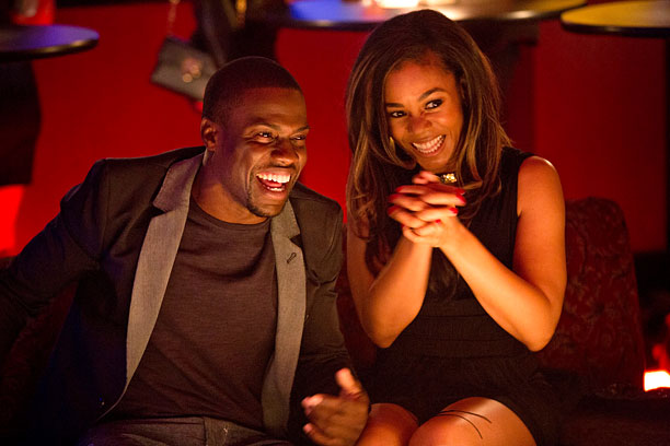 MATTERS OF THE HART Kevin Hart and Regina Hall flirt on-screen in About Last Night .