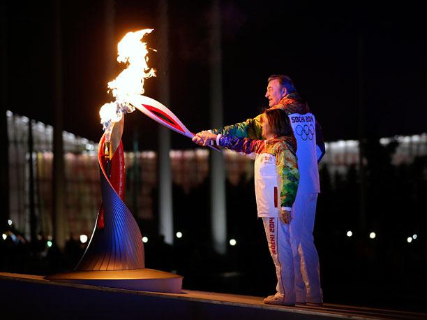 Winter Olympics 2014 | Former pairs figure skater Irina Rodnina and hockey star Vladislav Tretiak, who've each won three Olympic gold medals, had a long way to jog to…