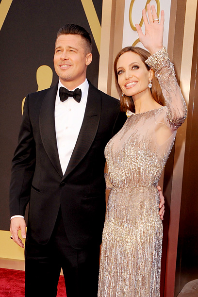 Oscars 2014 | The fiancés attended the 86th Annual Academy Awards where Pitt was nominated for producing 12 Years a Slave . Jolie eschewed her usual black in…