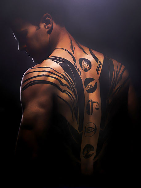 Like his fellow Dauntless denizens, Four is emphatic about ink. The most significant of his many tats are the five running down his spine. Each…