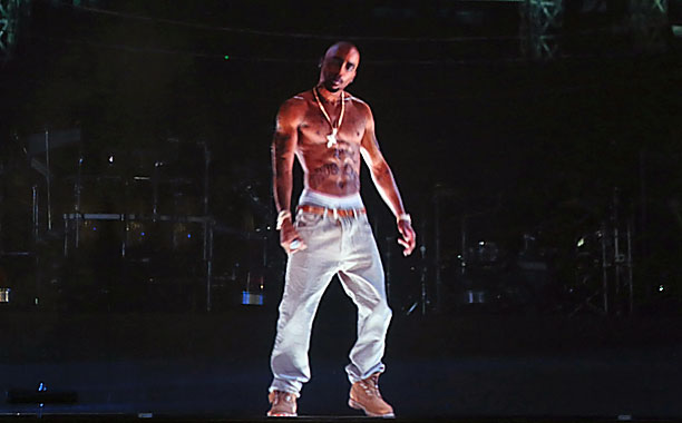 Tupac lives! In hologram form, at least, rapping at Coachella.