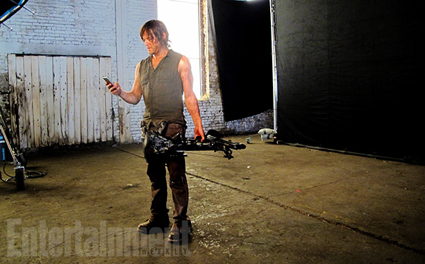 Norman checks his cell phone. Will this moment become another flash of Instagram-ready brilliance ?