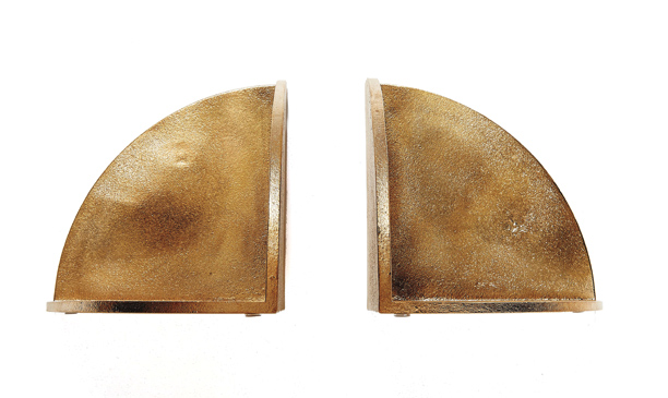 For the sophisticated bookavore, sophisticated brass bookends ($115 each, thefutureperfect.com ).