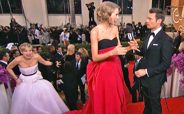 Jan. 12: Jennifer Lawrence creeps up on Taylor Swift talking to Ryan Seacrest during the Golden Globes pre-show