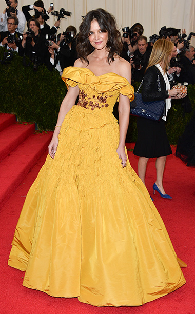 Katie Holmes channeled her inner Disney princess at the Met Gala in an off-the-shoulder Marchesa yellow gown reminiscent of Belle's iconic golden gown from animated…
