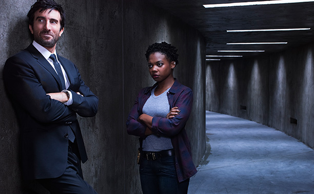 Det. Deena Pilgrim (Susan Heyward) and Det. Christian Walker (Sharlto Copley)