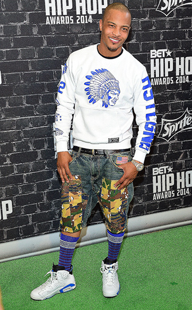 Though mixed prints can be a fashion do, rapper T.I.'s choice of a sweatshirt paired with blue socks pulled up high and patchwork camouflage denim…