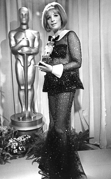 Style | Streisand took home an Oscar in 1969 for her performance in Funny Girl but her sequined black Scaasi jumpsuit — complete with a white Peter…