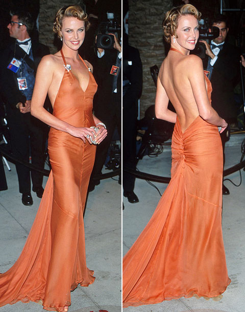 Style | Theron made jaws drop when she walked onto the red carpet at the 2000 Oscars in a V-neck orange Versace gown that showed off some…
