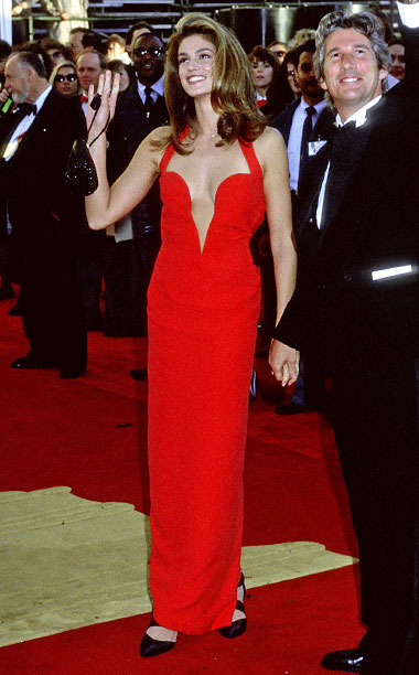 Style | Crawford looked every inch the supermodel when she showed up at the 1991 Oscars in a red plunging, halter-necked Versace gown. And while she may…