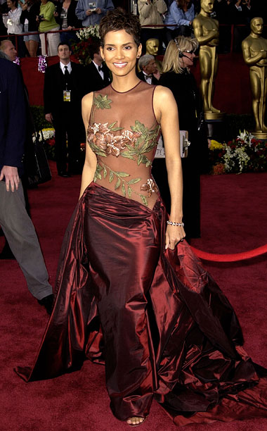 Style | Berry embraced her sexpot status at the 2002 Oscars in an Elie Saab dress with a transparent top that might have been a recipe for…