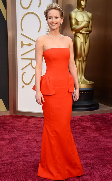 Oscars 2014 | Lawrence looked every inch the Hollywood bombshell in a bold red, peplum gown. Also making a return to the Oscar red carpet, J.Law's now signature…