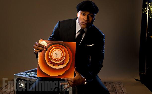 LL Cool J—the program's host—with 'Songs In The Key Of Life'
