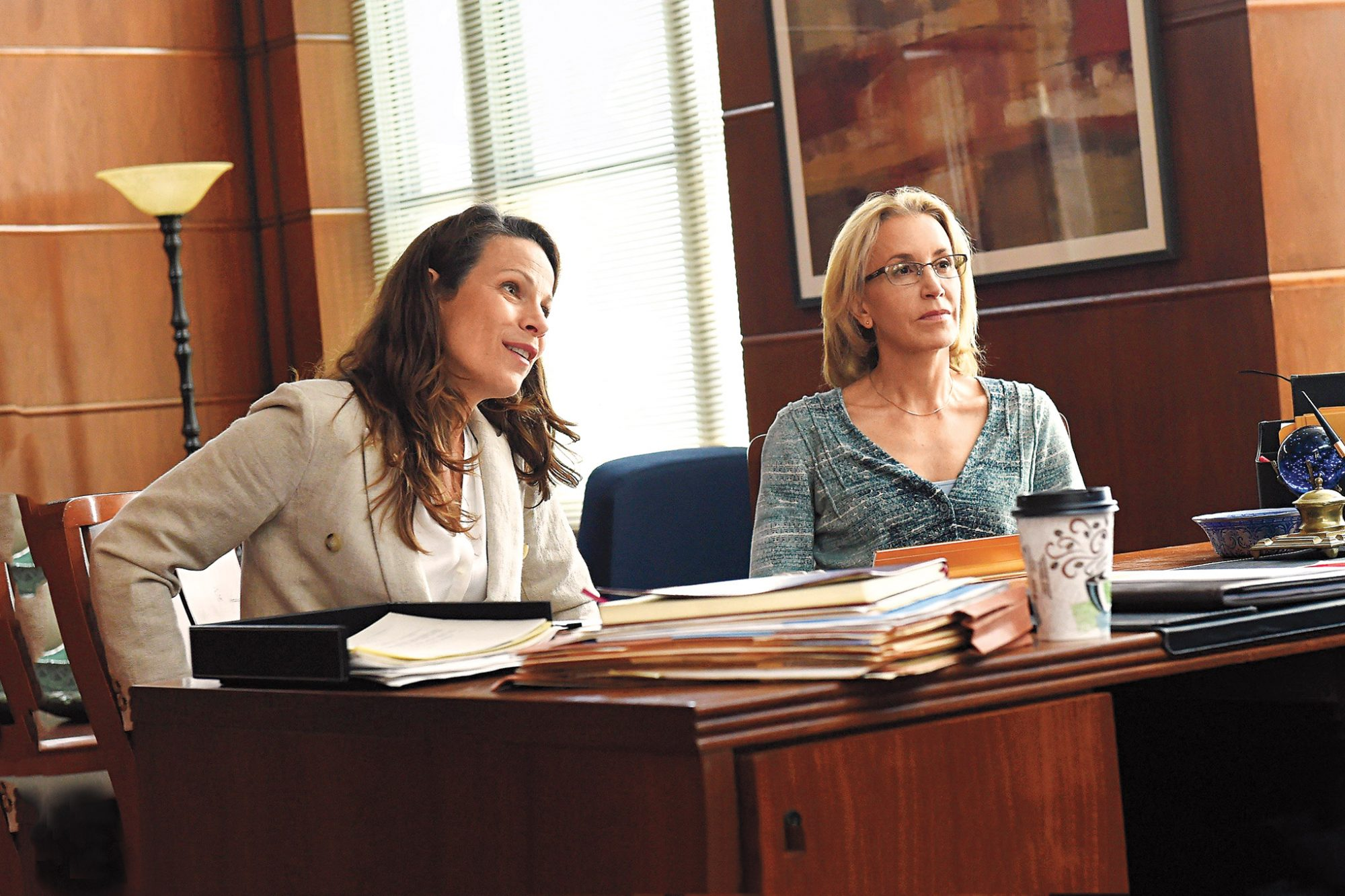 Lili Taylor and Felicity Huffman in American Crime