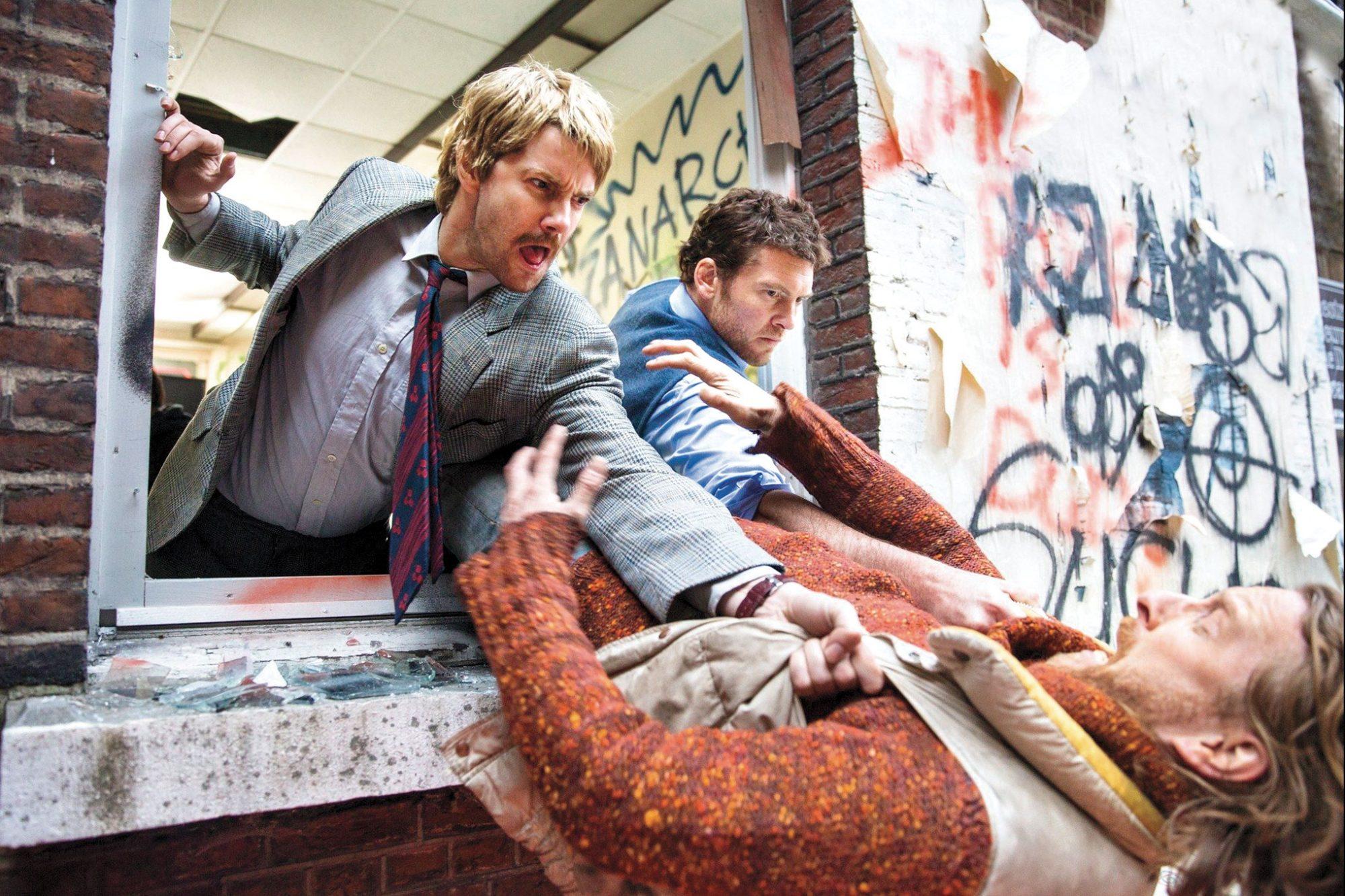 Jim Sturgess and Sam Worthington in Kidnapping Mr. Heineken