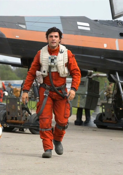 Isaac as Poe, in front of an X-wing and a familiar-looking droid