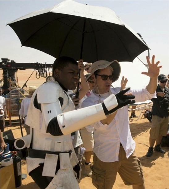 J.J. Abrams with John Boyega, whose Finn is a stormtrooper lost on the desert planet of Jakku