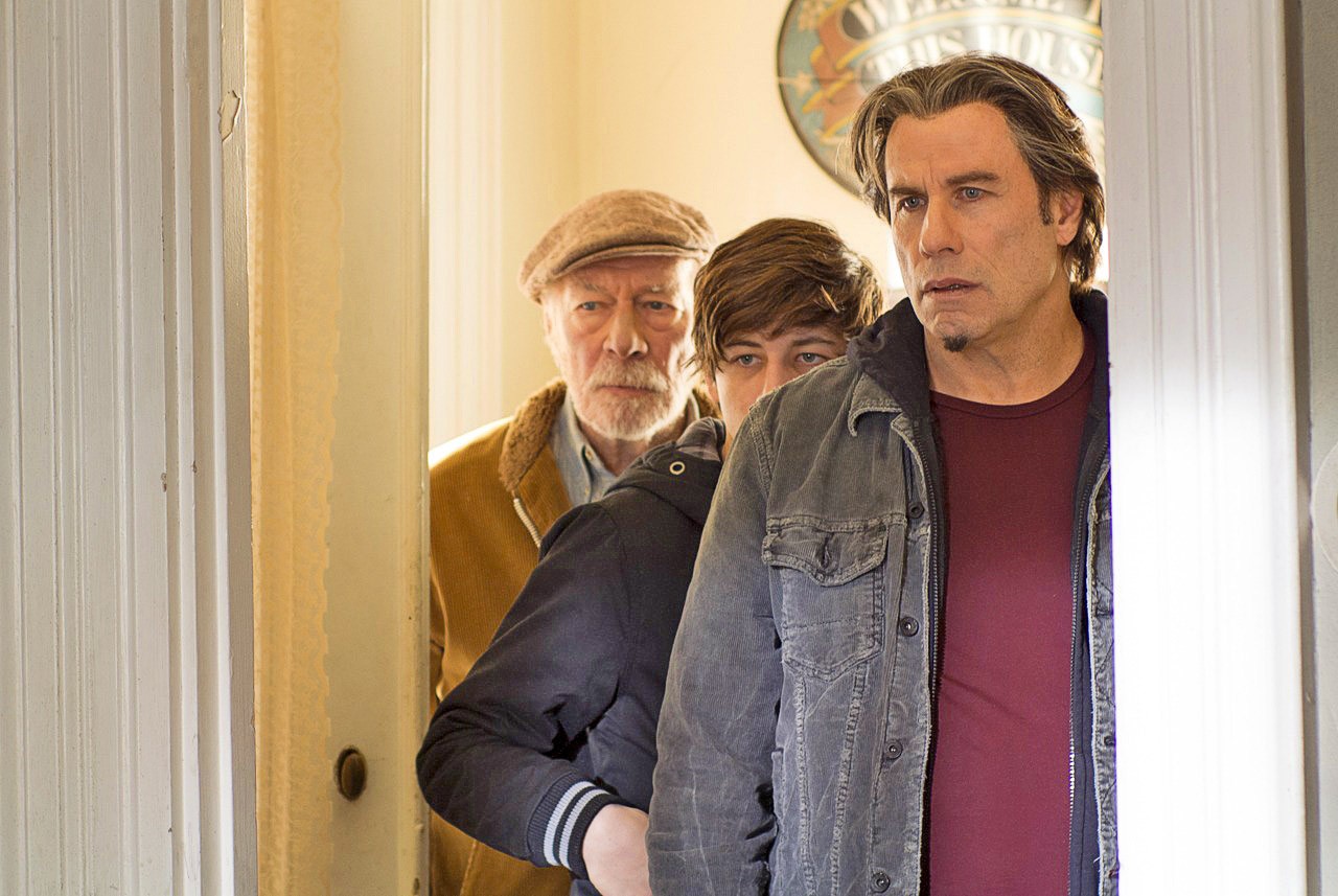 Christopher Plummer, Tye Sheridan, and John Travolta in The Forger
