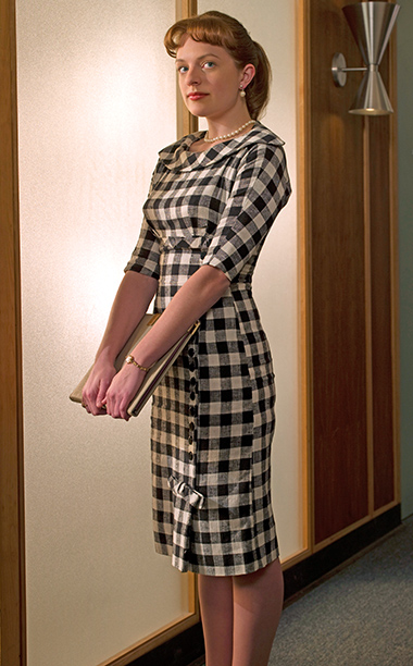Mad Men | In season 2, Peggy returned from her secret maternity leave looking pretty damn good. As a copywriter, Peggy was all business — and this form-fitting,…