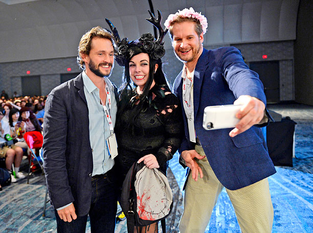 San Diego Comic-Con 2013, Hannibal, ... | Hugh Darcy and Bryan Fuller of Hannibal pose with a fan during their panel