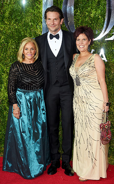 Bradley Cooper poses with his mom, Gloria Campano (L), and his sister Holly Cooper