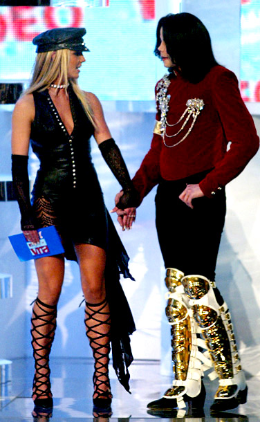 MTV Video Music Awards | Bad fashion is Toxic. On hand to present Michael Jackson's segment in 2002, Britney Spears sported an odd S&M leather dress with strappy boots that…
