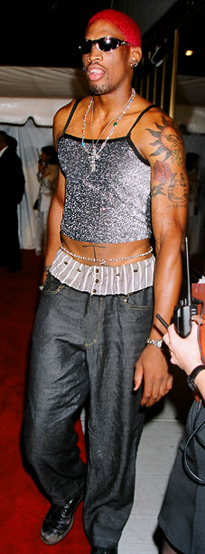 MTV Video Music Awards | Oh, Dennis Rodman, how we miss you. In 1995, Rodman rocked red hair, a stomach-bearing silver top, and subtle belly chain. It's so wrong it's…