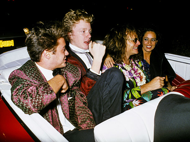 Robert Downey Jr., Anthony Michael Hall, David Lee Roth, and Sonia Braga enjoy a convertible at the 1984 after-party.