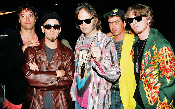 R.E.M. and Neil Young enjoy each other's company in 1993.