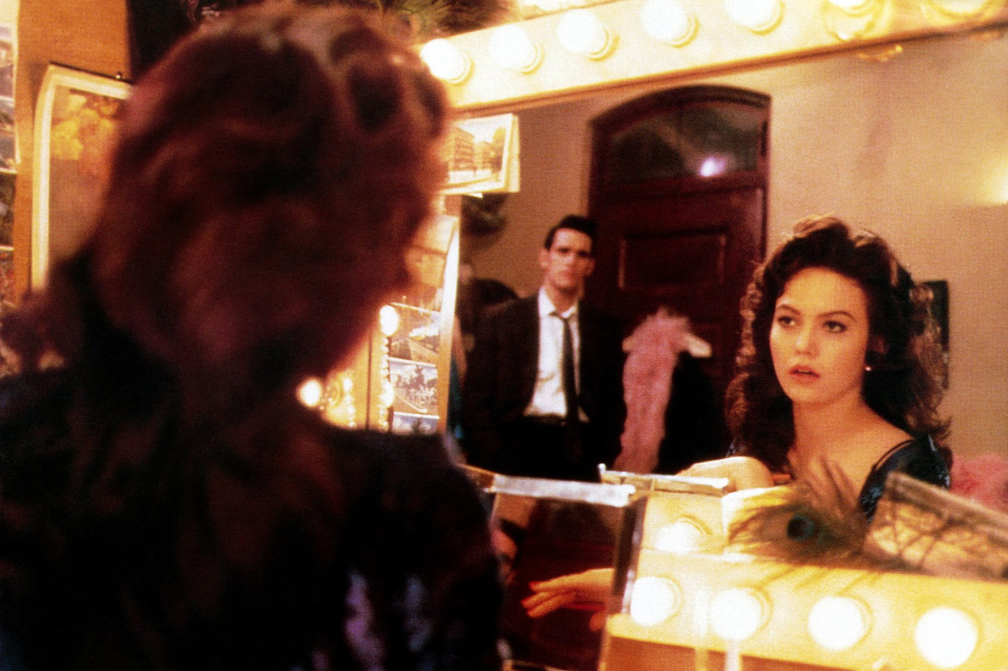 THE BIG TOWN, in mirror from left: Matt Dillon, Diane Lane, 1987, © Columbia/courtesy Everett Collec