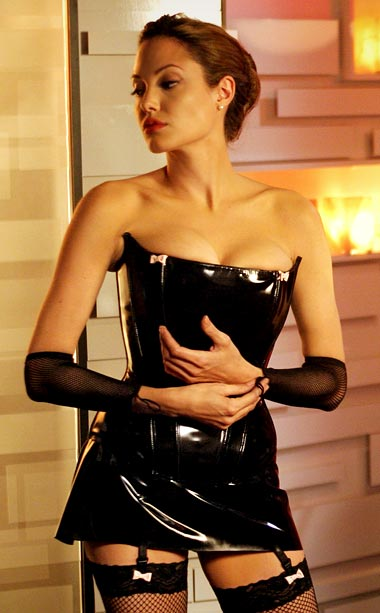 Angelina Jolie, Mr. & Mrs. Smith   Yowza! Jane's (Jolie) leather dominatrix getup was not just an effective — and disarming — disguise, it was part of a complete wardrobe that netted…