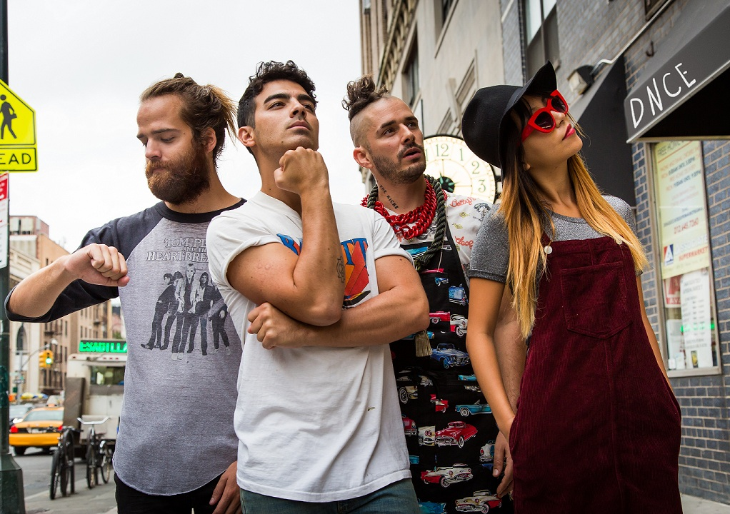 Watch frosting fly in DNCE's 'Cake By The Ocean' music video — exclusive
