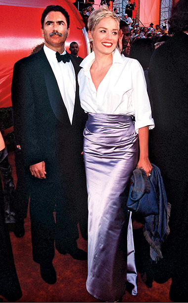 Sharon Stone in a Gap shirt and Vera Wang with Phil Bronstein, 1998 Academy Awards
