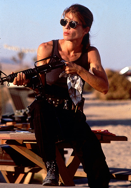 Linda Hamilton, Terminator 2: Judgment Day | Another sci-fi sequel directed by James Cameron, another heroine reborn as a gun-toting aggro-femme. When we first see former wallflower Sarah Conner in T2 ,…