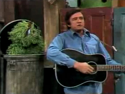 Johnny Cash, Sesame Street | JOHNNY CASH The Man in Black (okay, he still wore blue denim then) faced off against the monster in green (Oscar at his grumpiest) with…