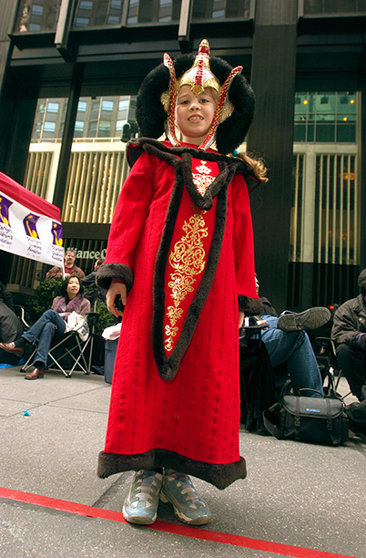 April 27, 2002: A young fan dressed as Queen Amidala gets ready for the New York City premiere of Attack of the Clones