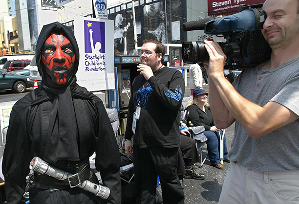April 11, 2002: An actor dressed as Darth Maul welcomes fans ahead of the Attack of the Clones premiere at Hollywood's Mann's Chinese Theater