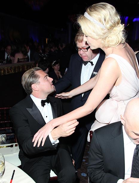 Leonardo DiCaprio, Elton John, and Charlize Theron