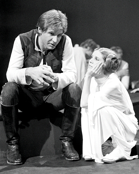 "Harrison Ford and Carrie Fisher during a break in the filming of ""The Star Wars Holiday"""