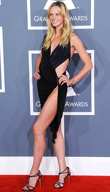 Swimsuit model Anne V showed everyone her bikini line when she attended the Grammys with boyfriend Adam Levine in 2012.