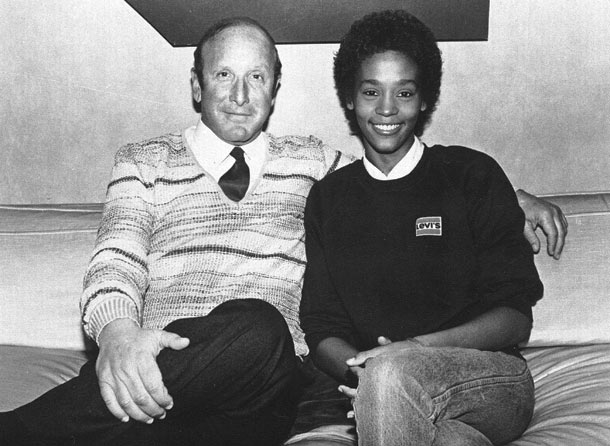 Whitney Houston | 1985 After impressing Arista Records head Clive Davis with her raw talent, Whitney is signed to the label and releases her self-titled debut. ''Saving All…