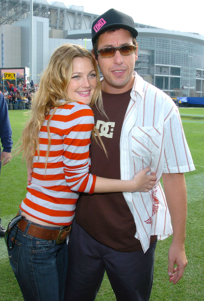 Drew Barrymore and Adam Sandler at Super Bowl XXXVIII (Carolina Panthers vs. New England Patriots) in 2004