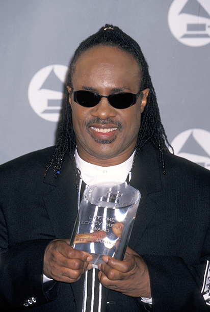 Stevie Wonder With His Grammy Lifetime Achievement Award