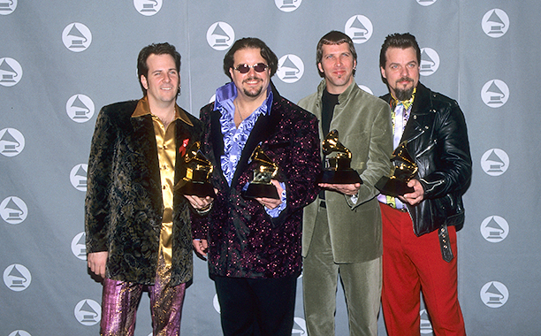 "Members of The Mavericks With Their Grammy for Best Country Performance by a Duo or Group with Vocal for ""Here Comes the Rain"""