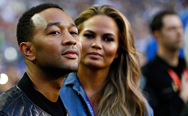 John Legend and Chrissy Teigen at Super Bowl XLIX (New England Patriots vs. Seattle Seahawks) in 2015