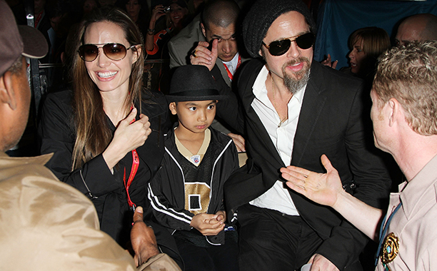 Angelina Jolie, Maddox Jolie-Pitt, and Brad Pitt at Super Bowl XLIV (New Orleans Saints vs. Indianapolis Colts) in 2010