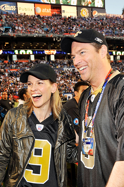 Hilary Swank and Harry Connick, Jr. at Super Bowl XLIV (New Orleans Saints vs. Indianapolis Colts) in 2010
